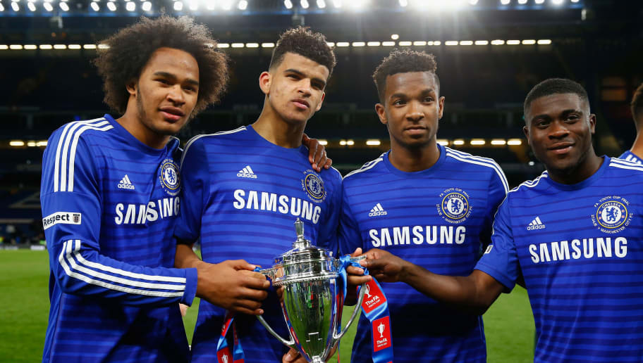 LONDON, ENGLAND - APRIL 27: (L-R) Isaiah Brown, Dominic Solanke, Kasey Palmer and Jeremie Boga of Chelsea with the winners trophy during the FA Youth Cup Final second leg match between Chelsea and Manchester City at Stamford Bridge on April 27, 2015 in London, England. (Photo by Julian Finney/Getty Images)