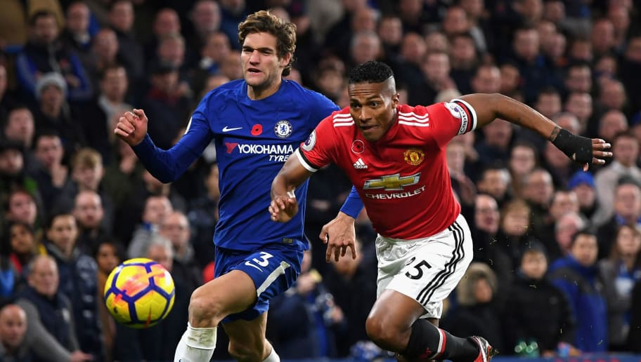 LONDON, ENGLAND - NOVEMBER 05: Marcos Alonso of Chelsea and Antonio Valencia of Manchester United battle for possession during the Premier League match between Chelsea and Manchester United at Stamford Bridge on November 5, 2017 in London, England.  (Photo by Shaun Botterill/Getty Images)