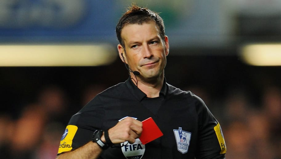 LONDON, ENGLAND - OCTOBER 28: Referee Mark Clattenburg takes out his red and yellow cards when sending off Fernando Torres of Chelsea during the Barclays Premier League match between Chelsea and Manchester United at Stamford Bridge on October 28, 2012 in London, England.  (Photo by Michael Regan/Getty Images)