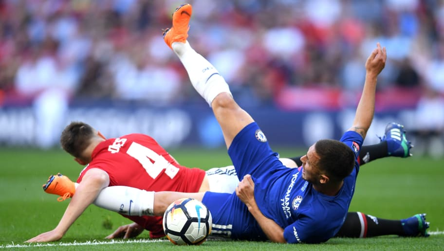 LONDON, ENGLAND - MAY 19:  Eden Hazard of Chelsea is fouled by Phil Jones of Manchester United for a penalty during The Emirates FA Cup Final between Chelsea and Manchester United at Wembley Stadium on May 19, 2018 in London, England.  (Photo by Laurence Griffiths/Getty Images)