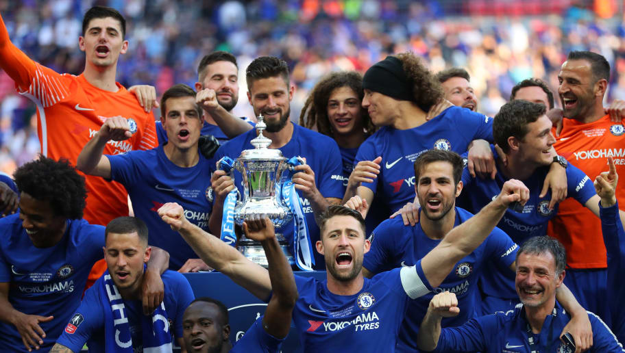 LONDON, ENGLAND - MAY 19: Gary Cahill of Chelsea celebrates with his team mates after winning The Emirates FA Cup Final between Chelsea and Manchester United at Wembley Stadium on May 19, 2018 in London, England. (Photo by Catherine Ivill/Getty Images)