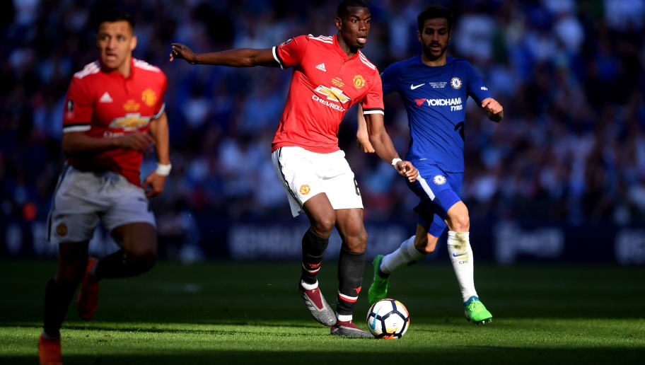 LONDON, ENGLAND - MAY 19:  Paul Pogba of Manchester United runs with the ball under pressure from Cesc Fabregas of Chelsea  during The Emirates FA Cup Final between Chelsea and Manchester United at Wembley Stadium on May 19, 2018 in London, England.  (Photo by Laurence Griffiths/Getty Images)