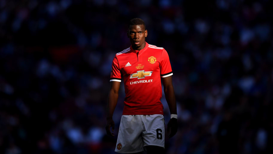 LONDON, ENGLAND - MAY 19:  Paul Pogba of Manchester United looks on during The Emirates FA Cup Final between Chelsea and Manchester United at Wembley Stadium on May 19, 2018 in London, England.  (Photo by Laurence Griffiths/Getty Images)