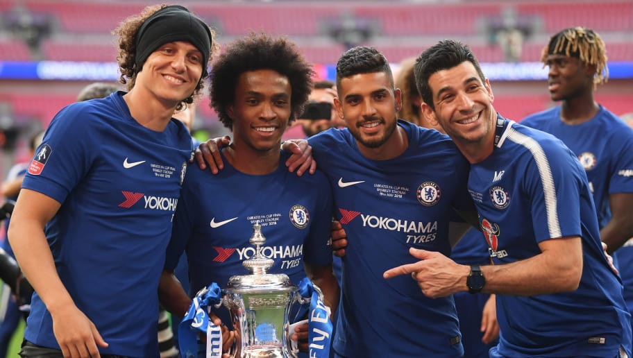 LONDON, ENGLAND - MAY 19:  David Luiz, Willian, and Emerson Palmieri of Chelsea pose with the Emirates FA Cup Trophy following their sides victoy in The Emirates FA Cup Final between Chelsea and Manchester United at Wembley Stadium on May 19, 2018 in London, England.  (Photo by Laurence Griffiths/Getty Images)
