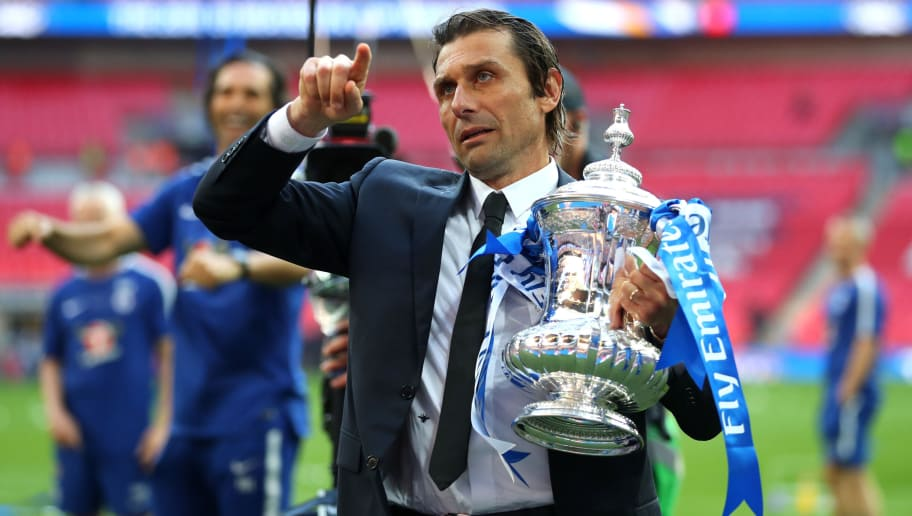 LONDON, ENGLAND - MAY 19:  Antonio Conte, Manager of Chelsea holds the Emirates FA Cup trophy following his side's win during The Emirates FA Cup Final between Chelsea and Manchester United at Wembley Stadium on May 19, 2018 in London, England.  (Photo by Catherine Ivill/Getty Images)