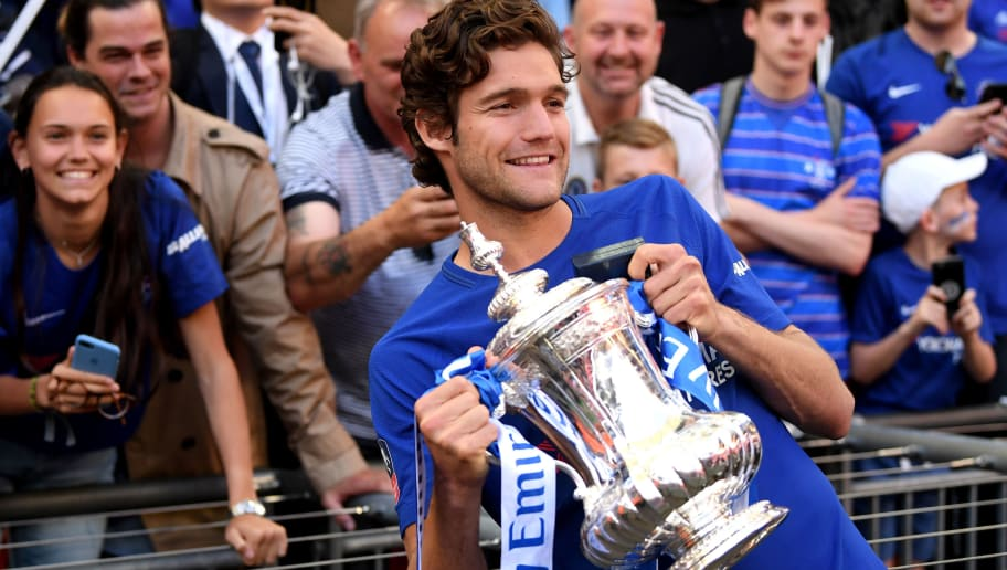 LONDON, ENGLAND - MAY 19:  Marcos Alonso of Chelsea poses with the Emirates FA Cup trophy following his side's win during The Emirates FA Cup Final between Chelsea and Manchester United at Wembley Stadium on May 19, 2018 in London, England.  (Photo by Laurence Griffiths/Getty Images)