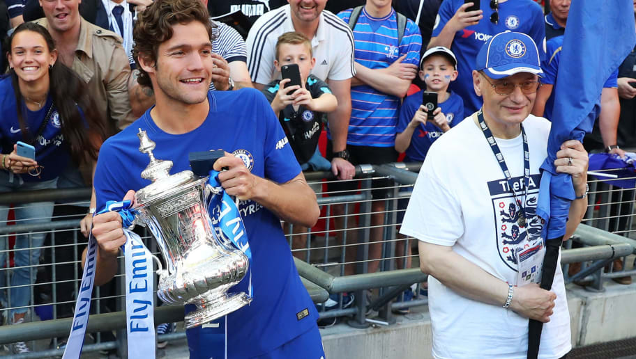 LONDON, ENGLAND - MAY 19:  Marcos Alonso of Chelsea poses with the Emirates FA Cup trophy following his sides victory in The Emirates FA Cup Final between Chelsea and Manchester United at Wembley Stadium on May 19, 2018 in London, England.  (Photo by Catherine Ivill/Getty Images)