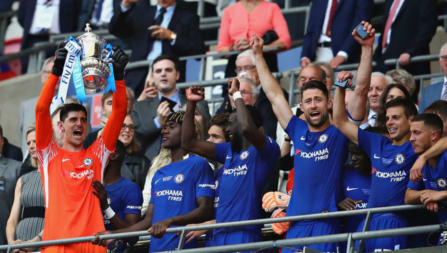LONDON, ENGLAND - MAY 19:  Thibaut Courtois of Chelsea lifts the FA Cup trophy after his side won during the Emirates FA Cup Final between Chelsea and Manchester United at Wembley Stadium on May 19, 2018 in London, England.  (Photo by Chris Brunskill Ltd/Getty Images)