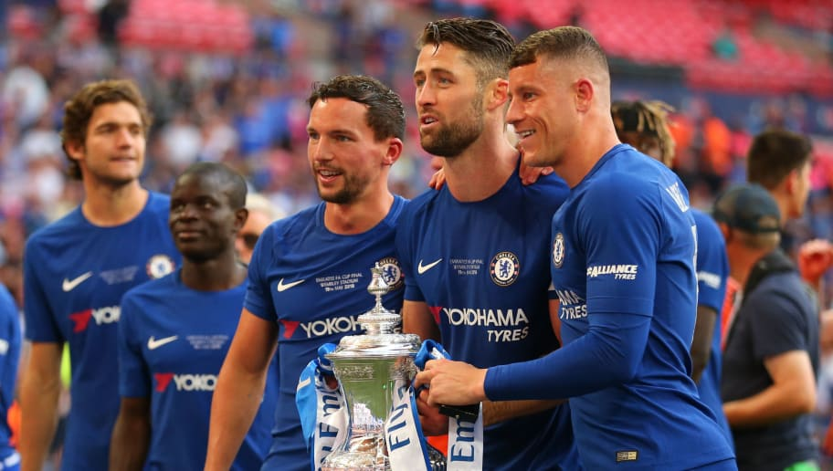 LONDON, ENGLAND - MAY 19:   Danny Drinkwater, Gary Cahill and Ross Barkley of Chelsea pose with the trophy at the end of the Emirates FA Cup Final between Chelsea and Manchester United at Wembley Stadium on May 19, 2018 in London, England. (Photo by Robbie Jay Barratt - AMA/Getty Images)