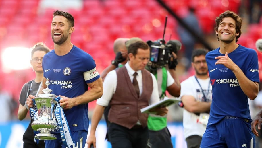 LONDON, ENGLAND - MAY 19:  Gary Cahill of Chelsea celebrates with the trophy and his team-mate Marcos Alonso at the end of the Emirates FA Cup Final between Chelsea and Manchester United at Wembley Stadium on May 19, 2018 in London, England. (Photo by Matthew Ashton - AMA/Getty Images)