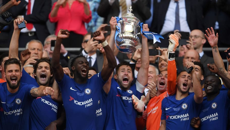 LONDON, ENGLAND - MAY 19:  Gary Cahill of Chelsea lifts the Emirates FA Cup trophy following his sides victory in The Emirates FA Cup Final between Chelsea and Manchester United at Wembley Stadium on May 19, 2018 in London, England.  (Photo by Laurence Griffiths/Getty Images)