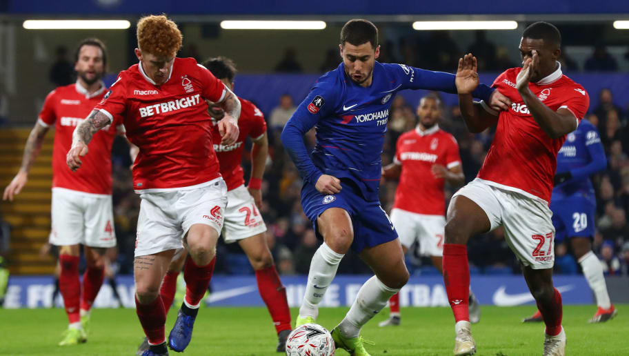 LONDON, ENGLAND - JANUARY 05:  Eden Hazard of Chelsea is challenged by Tendayi Darikwa of Nottingham Forest and Jack Colback of Nottingham Forest during the FA Cup Third Round match between Chelsea and Nottingham Forest at Stamford Bridge on January 5, 2019 in London, United Kingdom.  (Photo by Clive Rose/Getty Images)