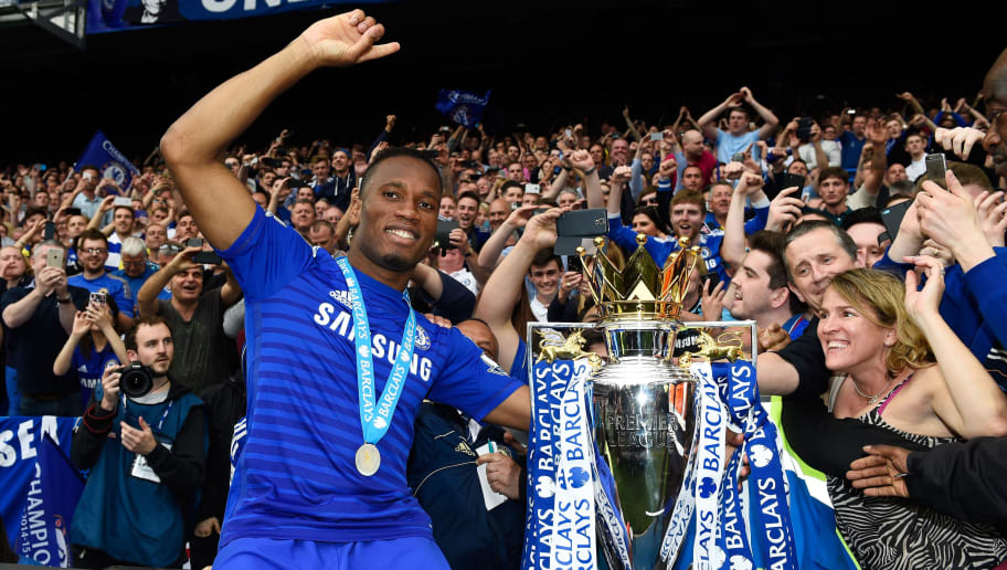 LONDON, ENGLAND - MAY 24:  Didier Drogba of Chelsea celebrates with fans and the trophy  after the Barclays Premier League match between Chelsea and Sunderland at Stamford Bridge on May 24, 2015 in London, England. Chelsea were crowned Premier League champions.  (Photo by Mike Hewitt/Getty Images)