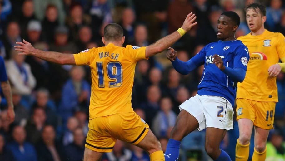 CHESTERFIELD, ENGLAND - MAY 07:  Tendayi Darikwa of Chesterfield is tackled by John Welsh of Preston North End during the Sky Bet League One Playoff Semi-Final, first leg match between Chesterfield and Preston North End at the Proact Stadium on May 7, 2015 in Chesterfield, England.  (Photo by Alex Livesey/Getty Images)