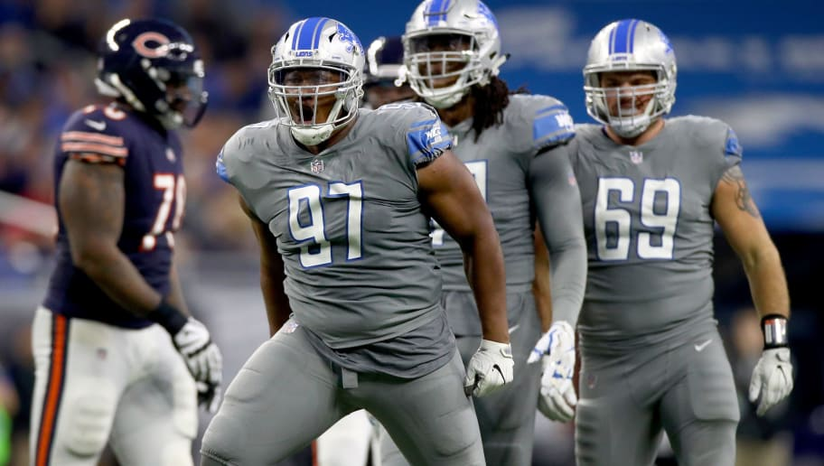 DETROIT, MI - DECEMBER 16: Detroit Lions defensive tackle Akeem Spence #97 celebrates a defensive play against the Chicago Bears during the second half at Ford Field on December 16, 2017 in Detroit, Michigan. (Photo by Gregory Shamus/Getty Images)