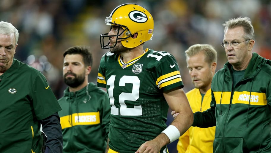 GREEN BAY, WI - SEPTEMBER 09:  Aaron Rodgers #12 of the Green Bay Packers is helped off the field after injuring his leg in the second quarter of a game against the Chicago Bears at Lambeau Field on September 9, 2018 in Green Bay, Wisconsin.  (Photo by Dylan Buell/Getty Images)