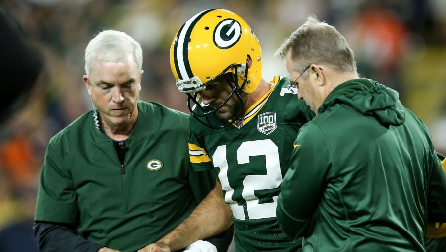 GREEN BAY, WI - SEPTEMBER 09:  Aaron Rodgers #12 of the Green Bay Packers is helped off the field after being injured in the second quarter against the Chicago Bears at Lambeau Field on September 9, 2018 in Green Bay, Wisconsin. (Photo by Dylan Buell/Getty Images)