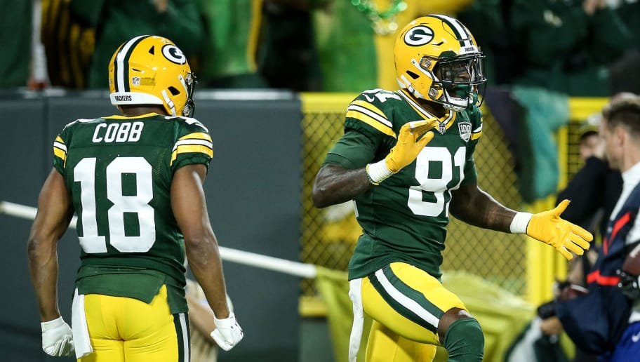 GREEN BAY, WI - SEPTEMBER 09:  Randall Cobb #18 and Geronimo Allison #81 of the Green Bay Packers celebrate after Allison scored a touchdown in the fourth quarter against the Chicago Bears at Lambeau Field on September 9, 2018 in Green Bay, Wisconsin. (Photo by Dylan Buell/Getty Images)