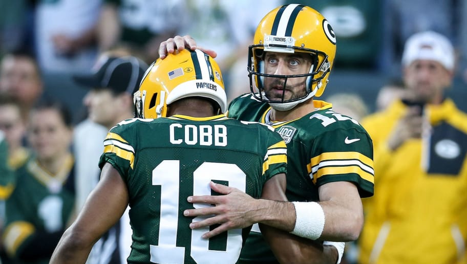 GREEN BAY, WI - SEPTEMBER 09:  Randall Cobb #18 and Aaron Rodgers #12 of the Green Bay Packers meet before the game against the Chicago Bears at Lambeau Field on September 9, 2018 in Green Bay, Wisconsin. (Photo by Dylan Buell/Getty Images)