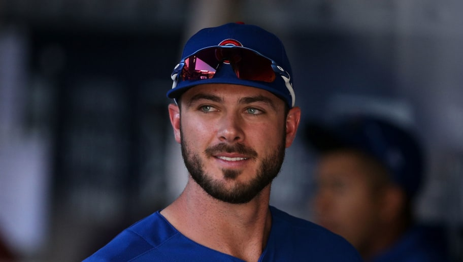 MILWAUKEE, WI - JUNE 13:  Kris Bryant #17 of the Chicago Cubs walks through the dugout in the eighth inning against the Milwaukee Brewers at Miller Park on June 13, 2018 in Milwaukee, Wisconsin.  (Photo by Dylan Buell/Getty Images)