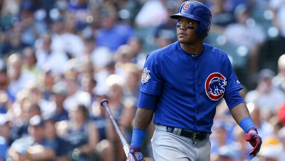 MILWAUKEE, WI - SEPTEMBER 23:  Addison Russell #27 of the Chicago Cubs walks back to the dugout after striking out in the ninth inning against the Milwaukee Brewers at Miller Park on September 23, 2017 in Milwaukee, Wisconsin.  (Photo by Dylan Buell/Getty Images)