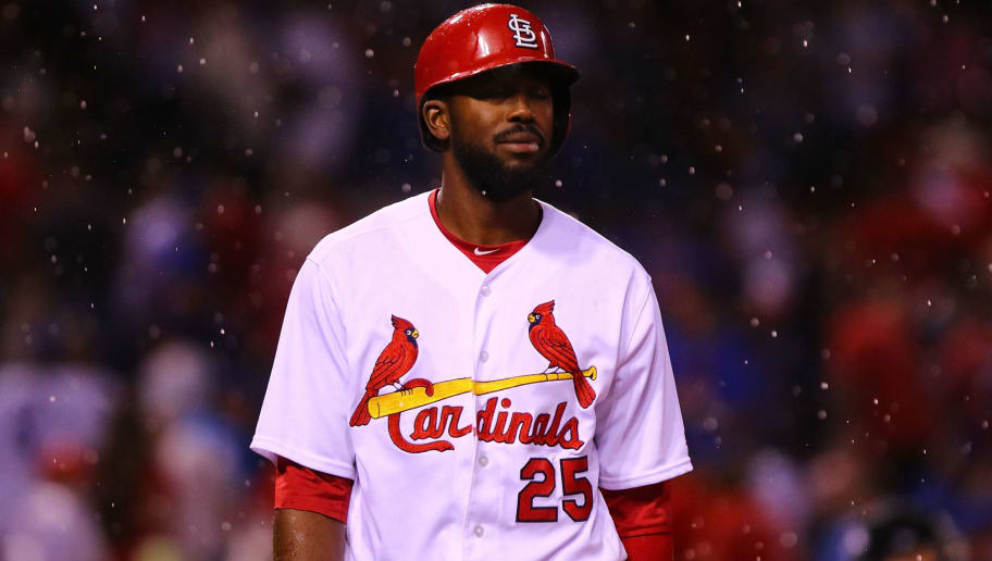 ST. LOUIS, MO - MAY 6:  Dexter Fowler #25 of the St. Louis Cardinals returns to the dugout after a rain delay was called in the third inning during the game against the Chicago Cubs at Busch Stadium on May 6, 2018 in St. Louis, Missouri.  (Photo by Dilip Vishwanat/Getty Images)