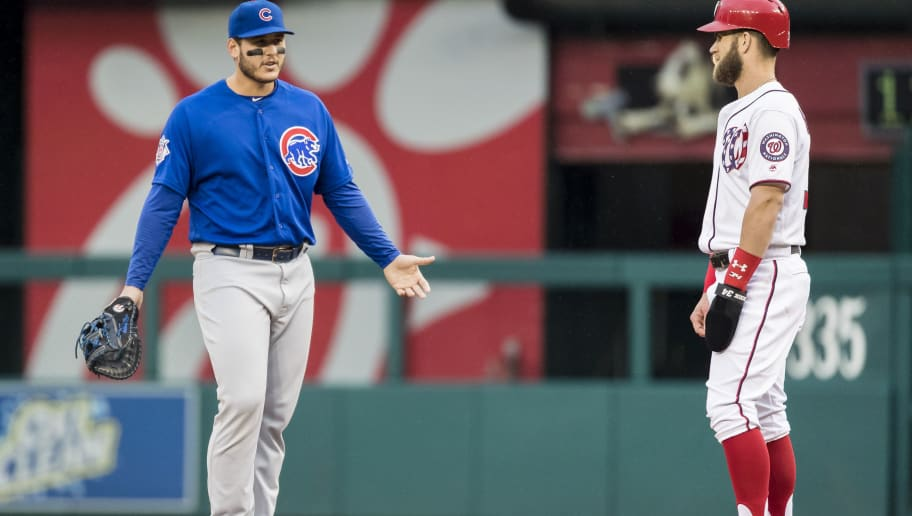 WASHINGTON, DC - SEPTEMBER 08: Anthony Rizzo #44 of the Chicago Cubs and Bryce Harper #34 of the Washington Nationals interact during the first inning of game one of a doubleheader at Nationals Park on September 8, 2018 in Washington, DC.  (Photo by Scott Taetsch/Getty Images)