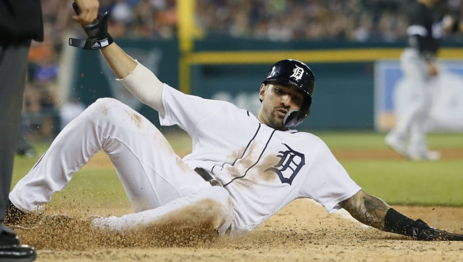 DETROIT, MI - MAY 25:  Nicholas Castellanos #9 of the Detroit Tigers scores from third base on a single by Jeimer Candelario of the Detroit Tigers to break a 4-4 tie against the Chicago White Sox during the eighth inning at Comerica Park on May 25, 2018 in Detroit, Michigan. The Tigers defeated the White Sox 5-4. (Photo by Duane Burleson/Getty Images)