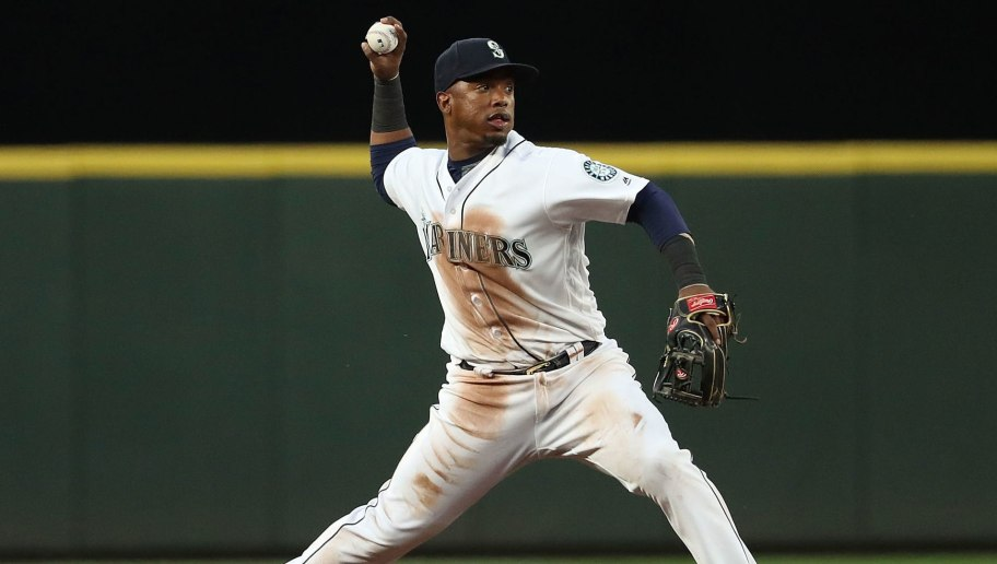 SEATTLE, WA - JULY 21:  Jean Segura #2 of the Seattle Mariners throws out Omar Narvaez #38 of the Chicago White Sox in the fifth inning during their game at Safeco Field on July 21, 2018 in Seattle, Washington.  (Photo by Abbie Parr/Getty Images)