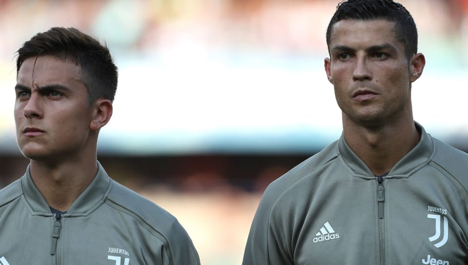 VERONA, ITALY - AUGUST 18:  Paulo Dybala and Cristiano Ronaldo of Juventus FC looks on before the Serie A match between Chievo Verona and Juventus at Stadio Marc'Antonio Bentegodi on August 18, 2018 in Verona, Italy.  (Photo by Marco Luzzani/Getty Images)
