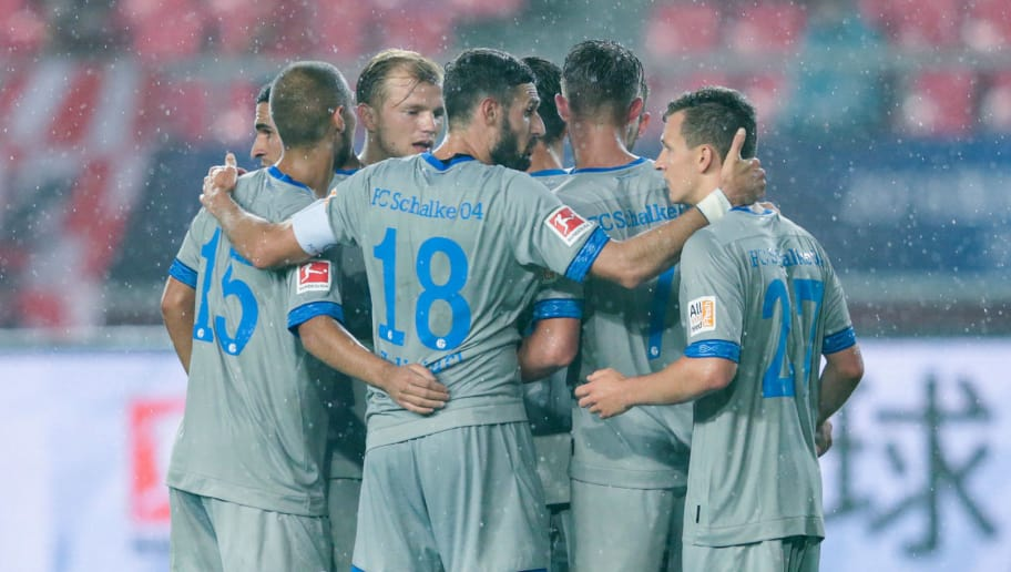 LANGFANG, CHINA - JULY 11:  Cedric Cedric Teuchert #23 of Schalke celebrates his goal with teammates during the 2018 Clubs Super Cup match between FC Schalke 04 and China Fortune at at Langfang Sports Center on July 11, 2018 in Langfang, China.  (Photo by Yanshan Zhang/Getty Images)