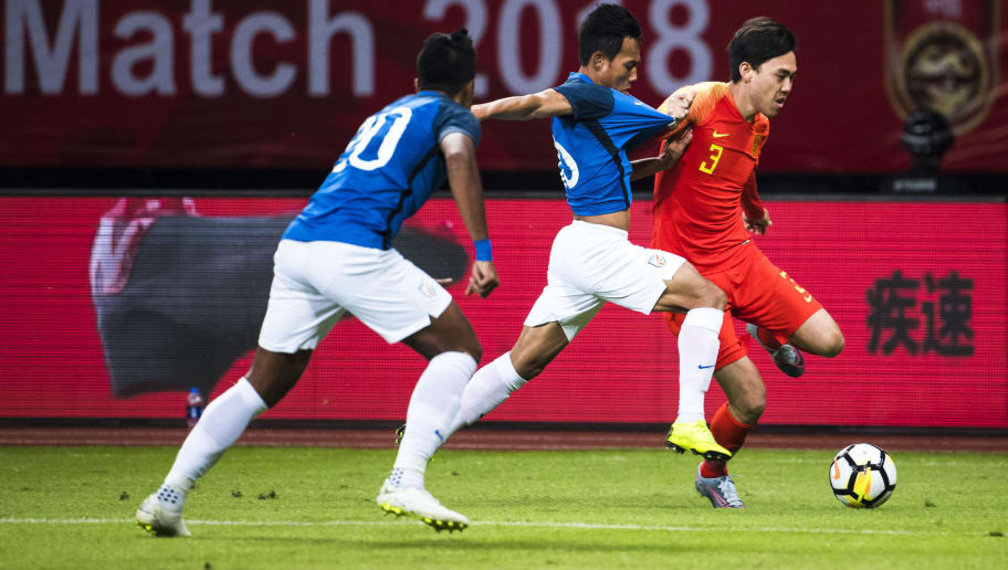 SUZHOU, CHINA - OCTOBER 13:  Li Xuepeng of China competes for the ball with Gurpreet Singh Sandhu of India during the CFA Team China International Football match in Suzhou Olympic Sports Center on October 13, 2018 in Suzhou, China.  (Photo by DI YIN/Getty Images)