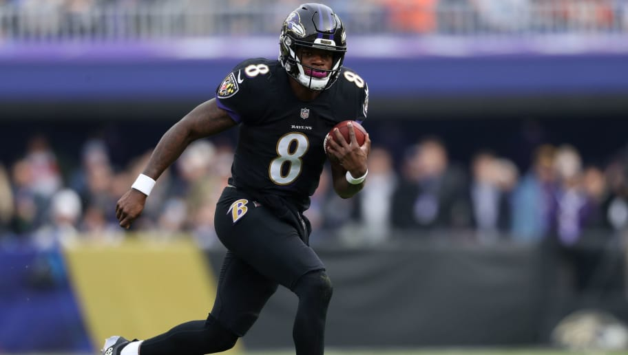 BALTIMORE, MD - NOVEMBER 18: Quarterback Lamar Jackson #8 of the Baltimore Ravens carries the ball in the first quarter against the Cincinnati Bengals at M&T Bank Stadium on November 18, 2018 in Baltimore, Maryland. (Photo by Patrick Smith/Getty Images)
