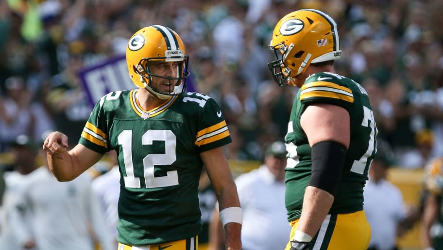 GREEN BAY, WI - SEPTEMBER 24:  Aaron Rodgers #12 of the Green Bay Packers meets with Bryan Bulaga #75 in the first quarter against the Cincinnati Bengals at Lambeau Field on September 24, 2017 in Green Bay, Wisconsin.  (Photo by Dylan Buell/Getty Images)