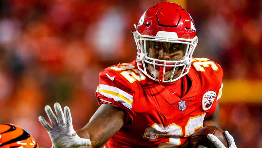 KANSAS CITY, MO - OCTOBER 21: Spencer Ware #32 of the Kansas City Chiefs stiff arms a player for the Cincinnati Bengals during the fourth quarter of the game at Arrowhead Stadium on October 21, 2018 in Kansas City, Kansas. (Photo by David Eulitt/Getty Images)