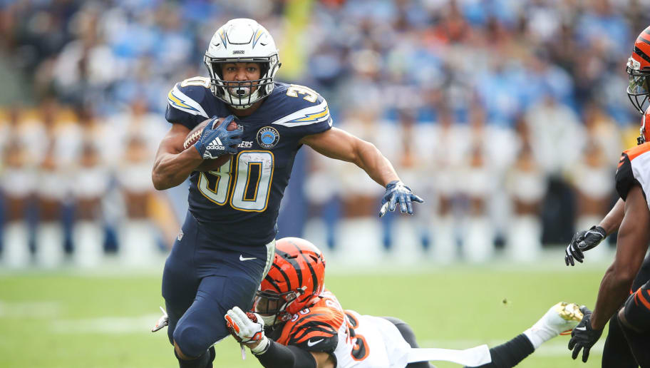 CARSON, CA - DECEMBER 09: Running back Austin Ekeler #30 of the Los Angeles Chargers makes a short run in the first quarter in front of free safety Jessie Bates #30 of the Cincinnati Bengals at StubHub Center on December 9, 2018 in Carson, California. (Photo by Sean M. Haffey/Getty Images)