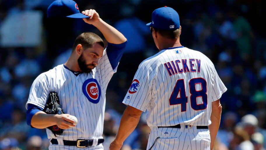 CHICAGO, IL - JULY 07: Tyler Chatwood #21 of the Chicago Cubs wipes his forehead while he talks with pitching coach Jim Hickey #48 during the first inning of their game against the Cincinnati Reds at Wrigley Field on July 7, 2018 in Chicago, Illinois.  (Photo by Jon Durr/Getty Images)