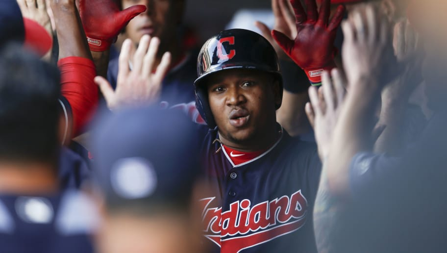 CLEVELAND, OH - JULY 11: Jose Ramirez #11 of the Cleveland Indians gets congratulations in the dugout after hitting a two run home run off Tyler Mahle #30 of the Cincinnati Reds during the first inning at Progressive Field on July 11, 2018 in Cleveland, Ohio. (Photo by Ron Schwane/Getty Images)