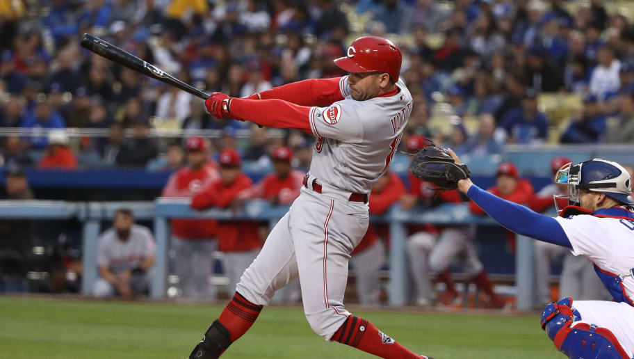 LOS ANGELES, CA - MAY 11:  Joey Votto #19 of the Cincinnati Reds hits an rbi single to center field in the first inning during the MLB game against the Los Angeles Dodgers at Dodger Stadium on May 11, 2018 in Los Angeles, California.  (Photo by Victor Decolongon/Getty Images)