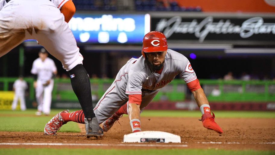 MIAMI, FL - SEPTEMBER 20: Billy Hamilton #6 of the Cincinnati Reds dives back to first base during the game against the Miami Marlins at Marlins Park on September 20, 2018 in Miami, Florida. (Photo by Mark Brown/Getty Images)