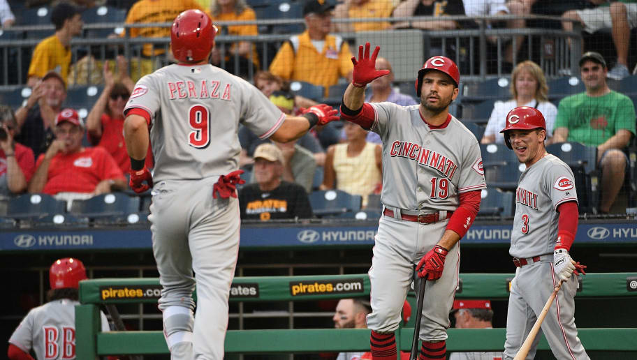 PITTSBURGH, PA - SEPTEMBER 05: Jose Peraza #9 of the Cincinnati Reds is greeted at home plate by Joey Votto #19 and Scooter Gennett #3 after hitting a solo home run in the first inning during the game against the Pittsburgh Pirates at PNC Park on September 5, 2018 in Pittsburgh, Pennsylvania. (Photo by Justin Berl/Getty Images)