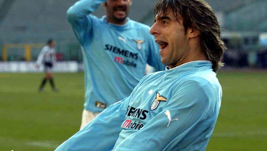 Claudio Lopez of Lazio celebrates scoring...