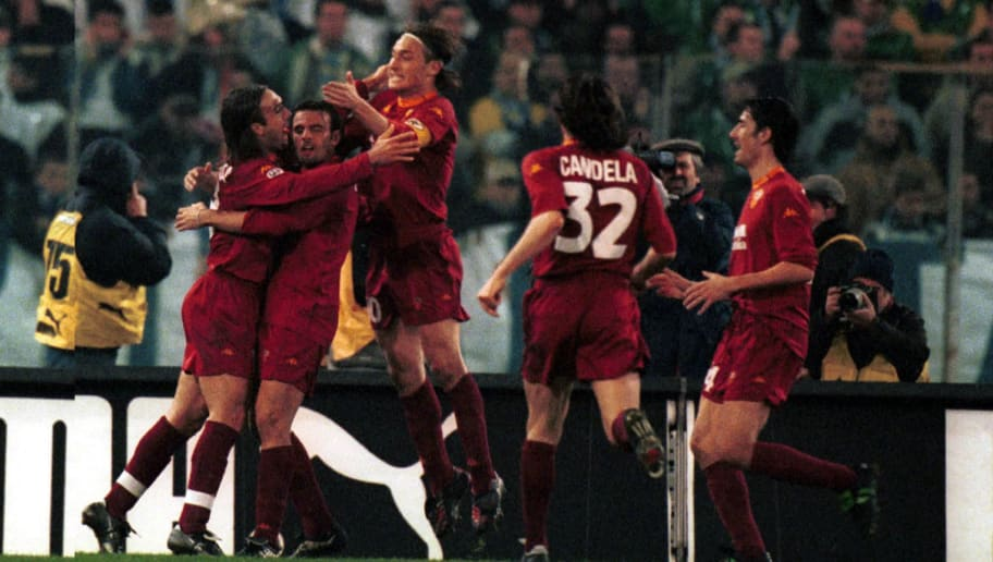 17 DEC 2000 . BATISTUTA, TOTTI, CANDELA AND DELVECCHIO CELEBRATING AFTER GOAL during the 11st round SERIE A game LAZIO Vs ROMA played at the OLYMPIC STADIUM, ROME.