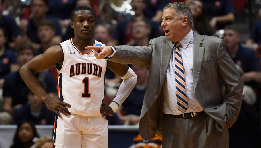 SAN DIEGO, CA - MARCH 18:  Head coach Bruce Pearl of the Auburn Tigers talks with Jared Harper #1 as they take on the Clemson Tigers in the first half during the second round of the 2018 NCAA Men's Basketball Tournament at Viejas Arena on March 18, 2018 in San Diego, California.  (Photo by Donald Miralle/Getty Images)