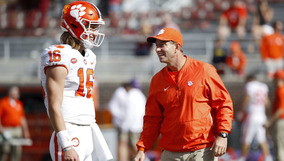 TALLAHASSEE, FL - OCTOBER 27: Head coach Dabo Swinney of the Clemson Tigers talks with quarterback Trevor Lawrence #16 before the game against the Florida State Seminoles at Doak Campbell Stadium on October 27, 2018 in Tallahassee, Florida. Clemson won 59-10. (Photo by Joe Robbins/Getty Images)
