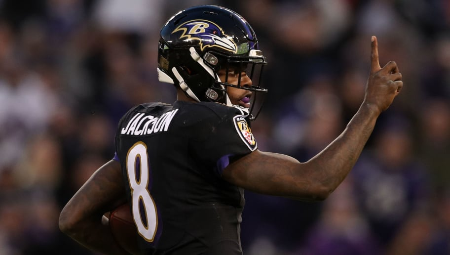 BALTIMORE, MARYLAND - DECEMBER 30: Quarterback Lamar Jackson #8 of the Baltimore Ravens reacts as he runs for a touchdown in the first quarter against the Cleveland Browns at M&T Bank Stadium on December 30, 2018 in Baltimore, Maryland. (Photo by Patrick Smith/Getty Images)