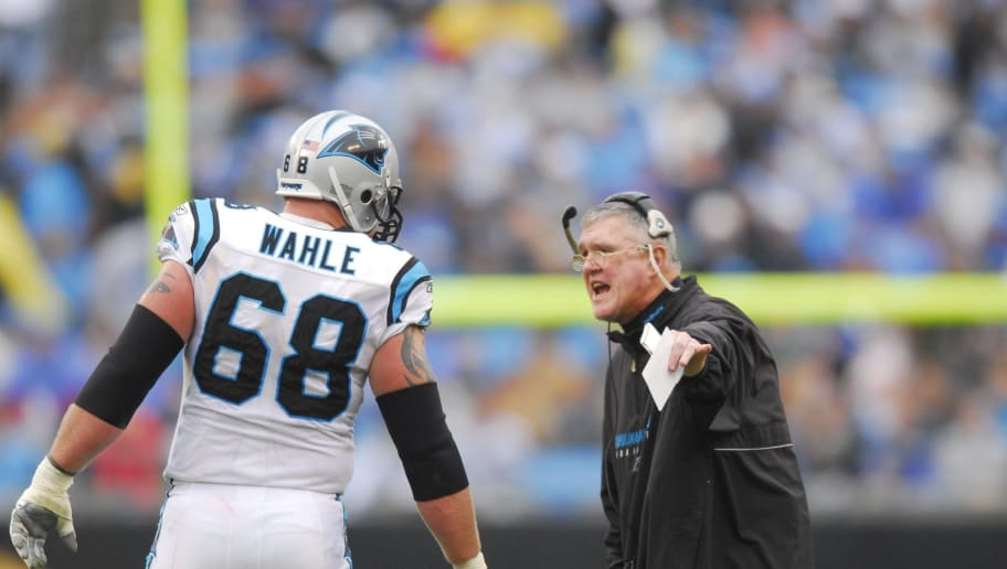 CHARLOTTE, NC - OCTOBER 8:  Offensive line coach Mike Maser of the Carolina Panthers talks with guard Mike Wahle #68 during the game against the Cleveland Browns on October 8, 2006, at Bank of America Stadium in Charlotte, North Carolina. Carolina won 20-12. (Photo by Grant Halverson/Getty Images)