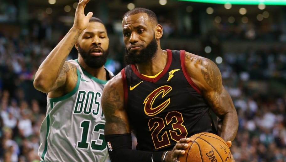BOSTON, MA - FEBRUARY 11:  Lebron James #23 of the Cleveland Cavaliers drives to the basket past Marcus Morris #13 of the Boston Celtics during the first quarter of a game at TD Garden on February 11, 2018 in Boston, Massachusetts. NOTE TO USER: User expressly acknowledges and agrees that, by downloading and or using this photograph, User is consenting to the terms and conditions of the Getty Images License Agreement.  (Photo by Adam Glanzman/Getty Images)