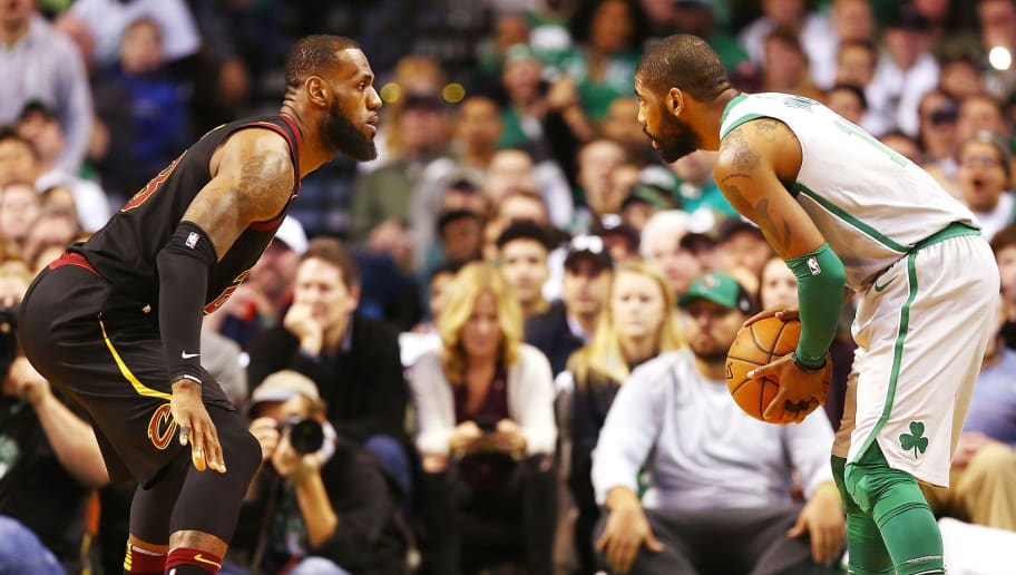 BOSTON, MA - FEBRUARY 11:  Kyrie Irving #11 of the Boston Celtics is guarded by Lebron James #23 of the Cleveland Cavaliers during the first quarter of a game at TD Garden on February 11, 2018 in Boston, Massachusetts. NOTE TO USER: User expressly acknowledges and agrees that, by downloading and or using this photograph, User is consenting to the terms and conditions of the Getty Images License Agreement.  (Photo by Adam Glanzman/Getty Images)
