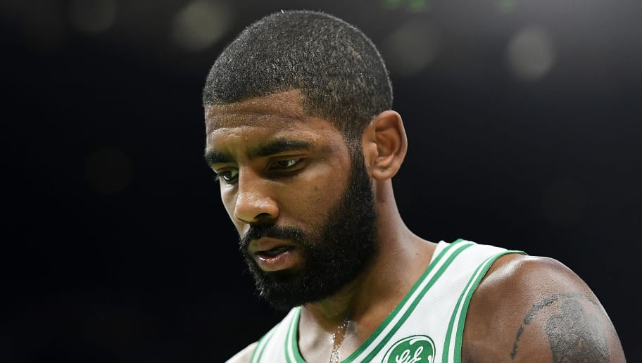 BOSTON, MA - NOVEMBER 30:  Kyrie Irving #11 of the Boston Celtics looks on during a game against the Cleveland Cavaliers at TD Garden on November 30, 2018 in Boston, Massachusetts. NOTE TO USER: User expressly acknowledges and agrees that, by downloading and or using this photograph, User is consenting to the terms and conditions of the Getty Images License Agreement. (Photo by Adam Glanzman/Getty Images)